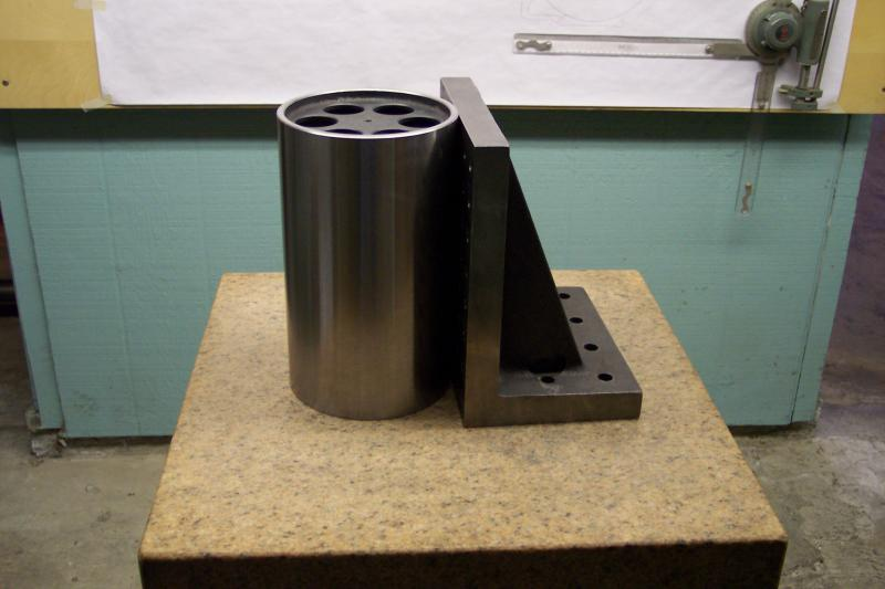 A cylindrical master square calibrating an angle plate.